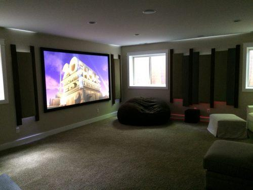 Basement theater features 4K, Acoustic panels, and LED lighting After