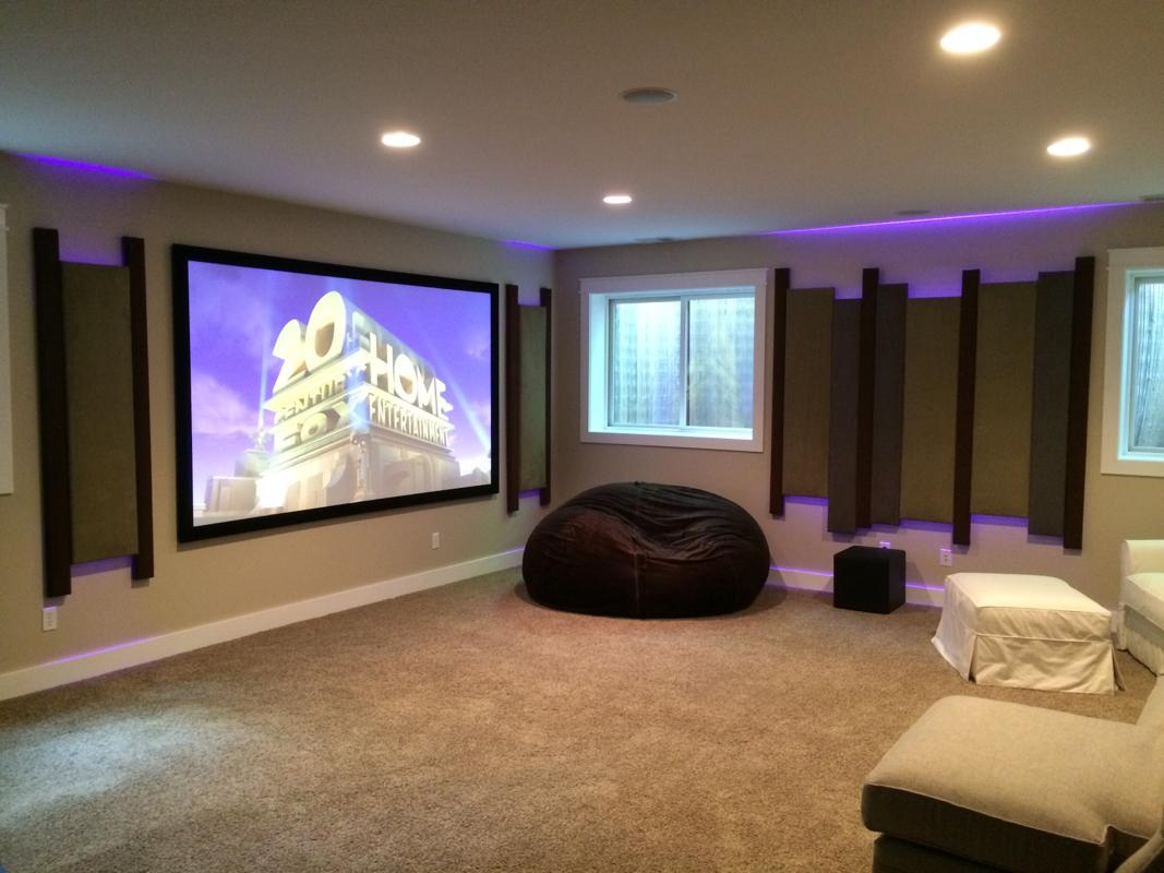 Basement theater features 4K, Acoustic panels, and LED lighting