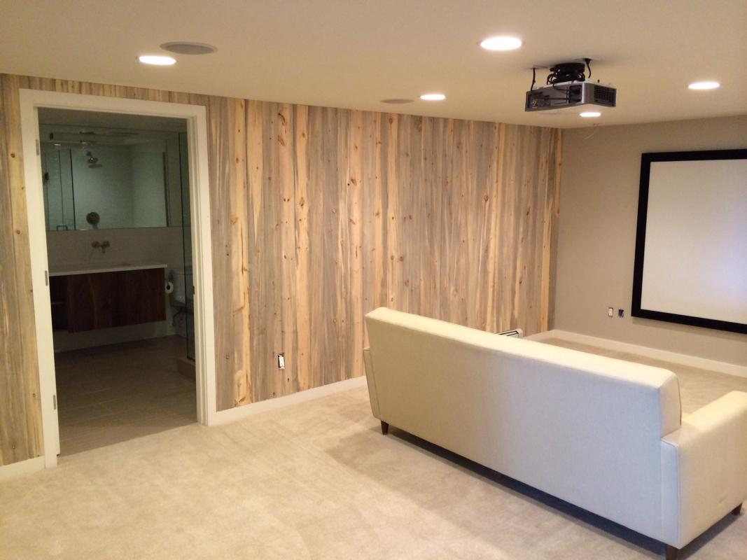 Modern basement theater highlights beetle-kill pine and Totem Kin In-wall speakers