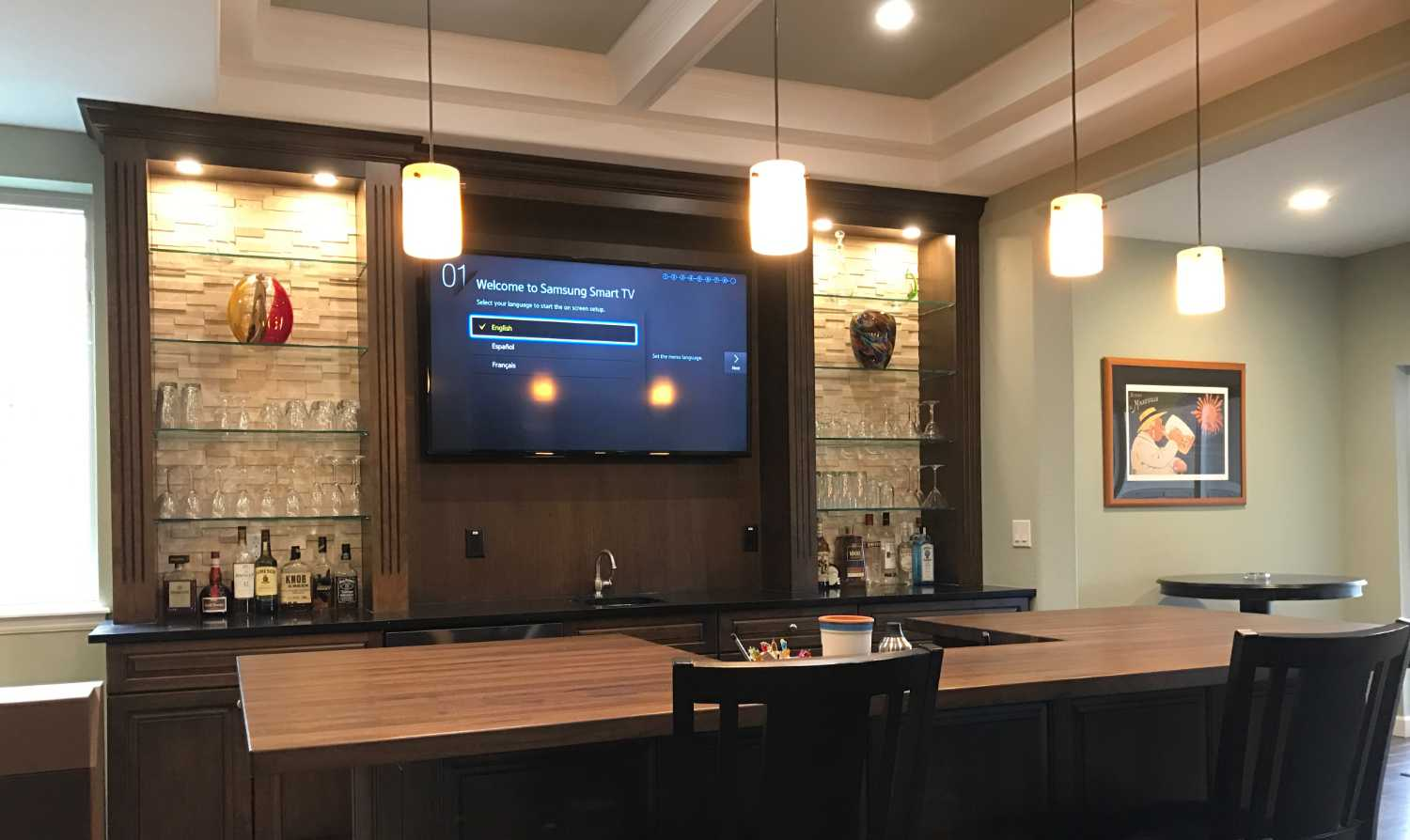 TV installed over bar in basement man cave